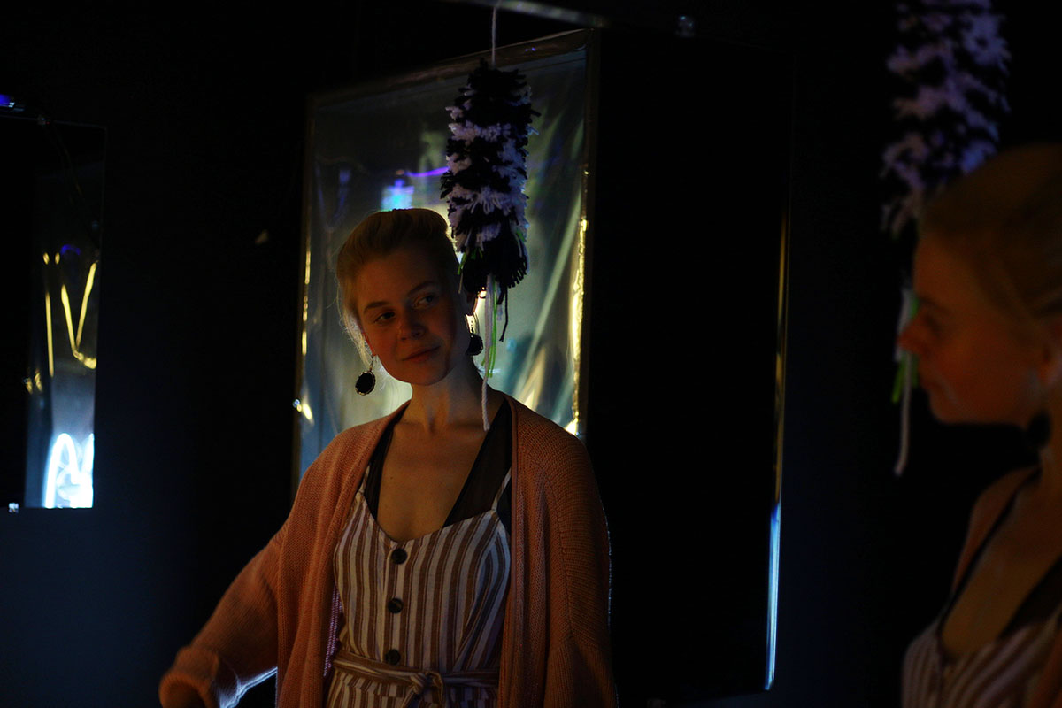 Heidi Johnson, a drawing and painting student, poses in her infinity room.