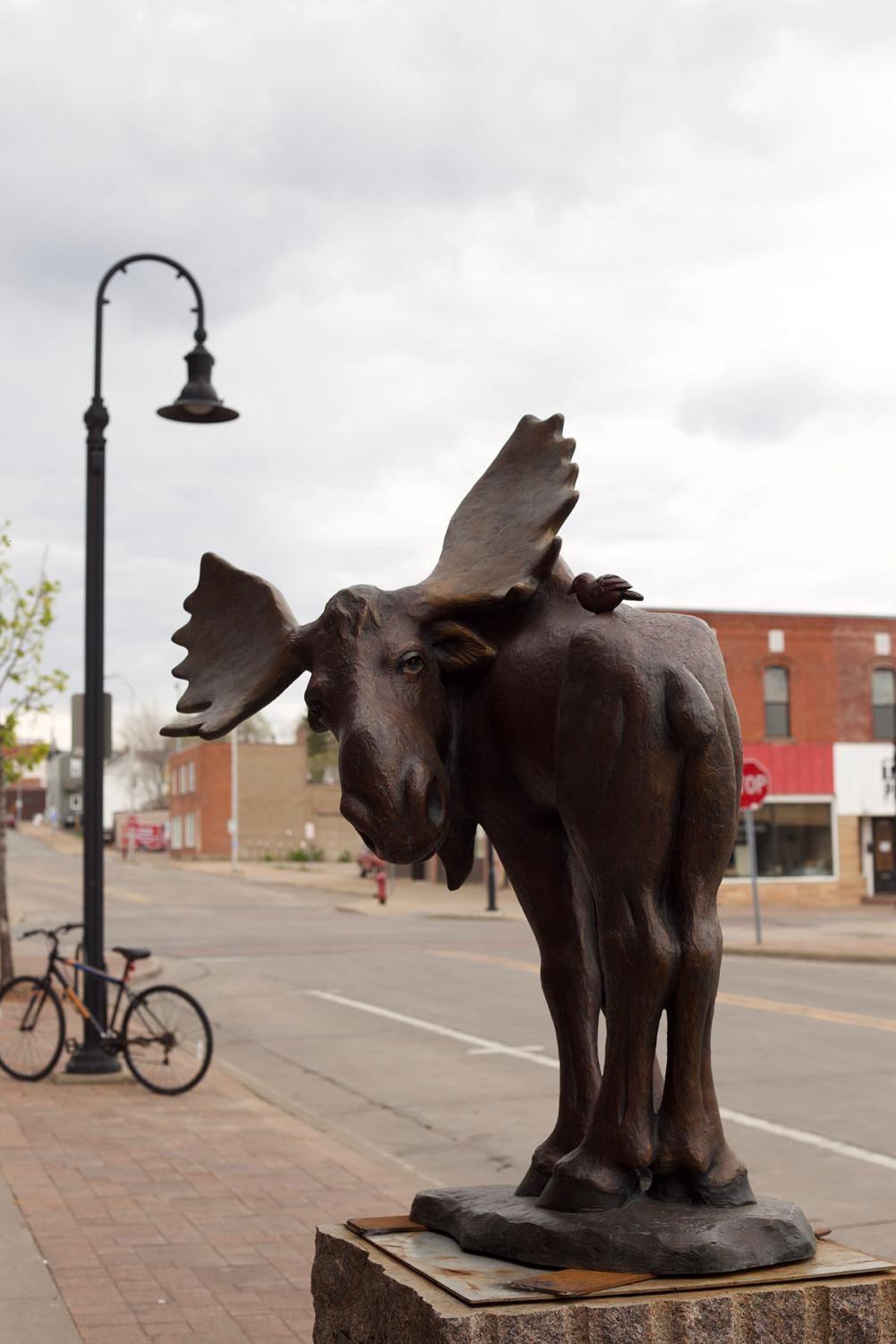 Untitled+and+by+an+unnamed+artist%2C+a+moose+with+a+tiny+bird+sits+outside+of+The+Livery+Restaurant+and+Saloon.