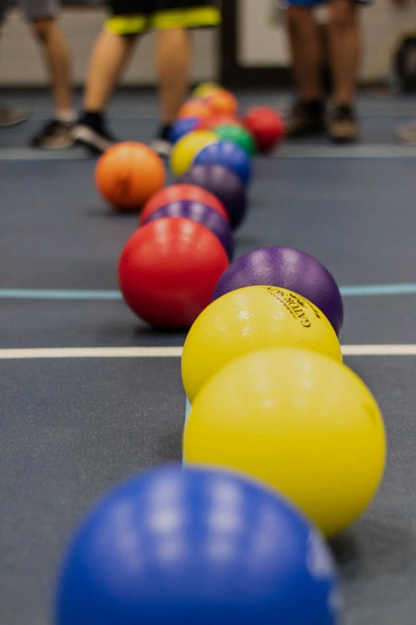 Dodgeballs are returned to the center line after each round.