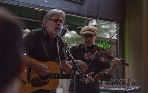 Guitarist, Duffy Duyfhuizen, and violinist, Olaf Lind, of Eggplant Heroes performed at Acoustic Cafe.