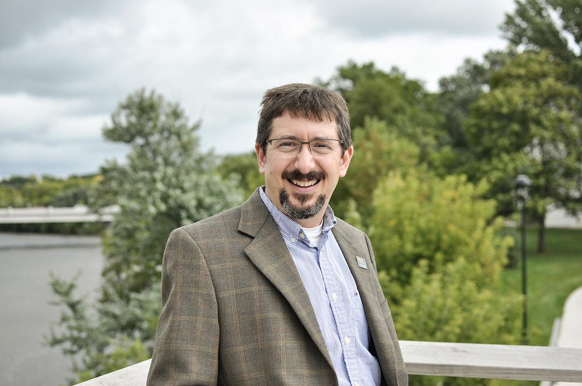 James Boulter, a professor of chemistry, poses on the UW-Eau Claire footbridge.