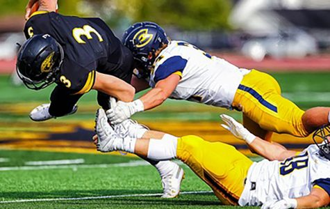 Alex Mashak makes the tackle in the game against UW Oshkosh.