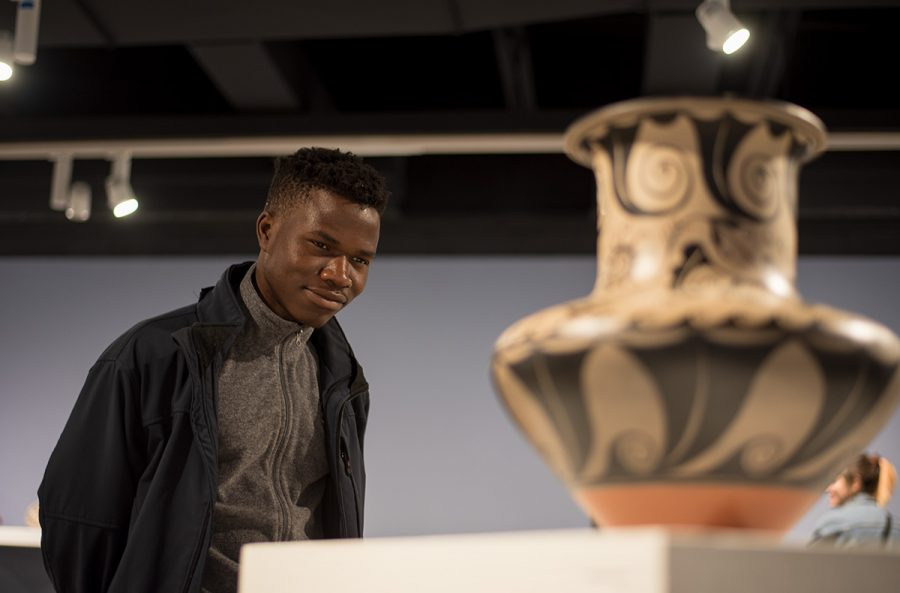 Olu+Famule%2C+a+third-year+biology+student%2C+admires+the+artwork+at+the+Ruth+Foster+Art+Gallery+during+the+open+reception+for+the+show+Special+Meanings%3A+The+Labelle-Miller+Southwest+Pottery+Collection.