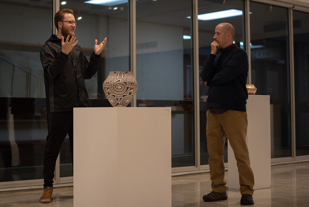 Jake Taylor, a fifth-year ceramics students, discusses pottery with Ned Gannon, an illustration professor at UW-Eau Claire.