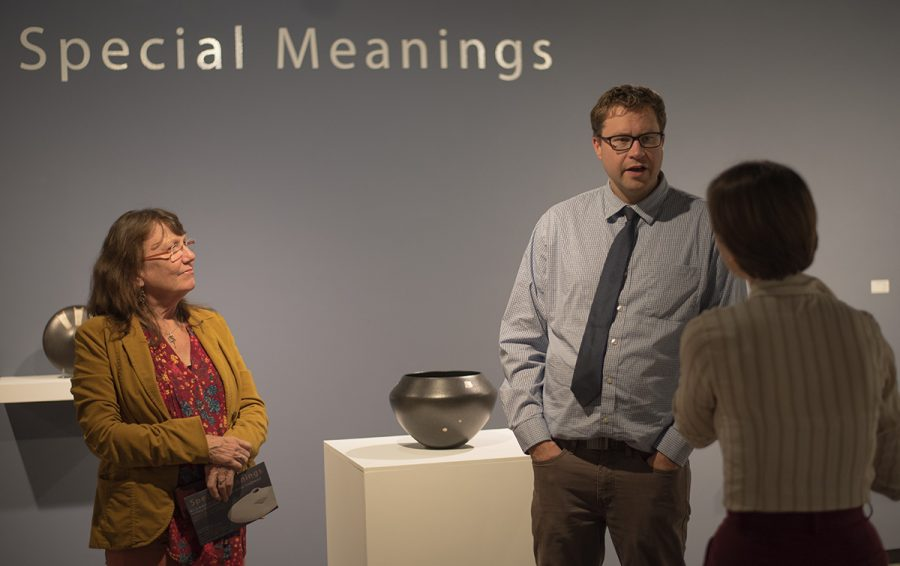 Susan O'Brien, the ceramics professor at UW-Eau Claire, listens in to a conversation about the opening reception of Special Meaning at the Ruth Foster Art Gallery.