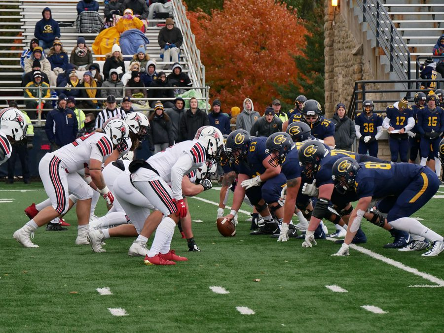 The+Blugolds+line+up+to+snap+the+ball+into+play.