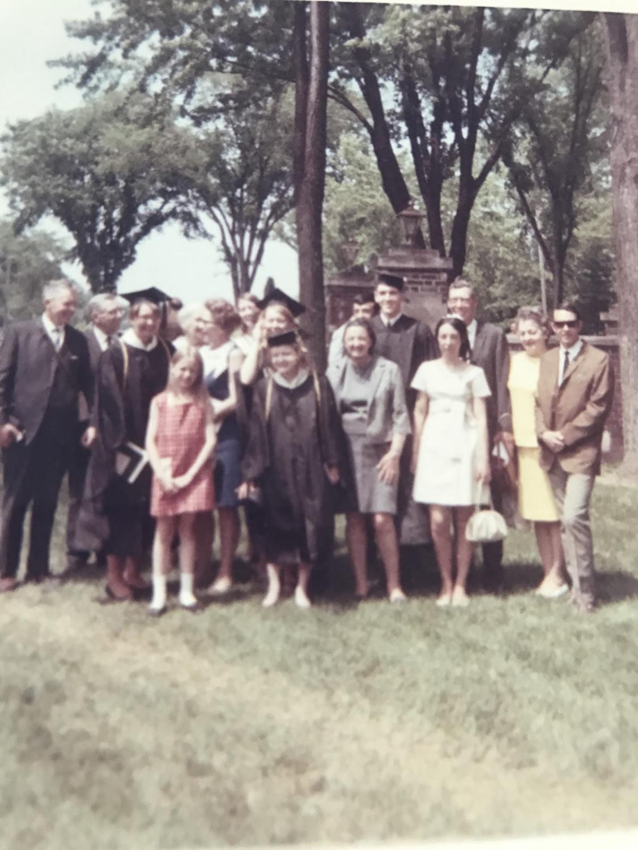 Cutler (center) graduating cum laude from UWEC on May 22, 1969.
