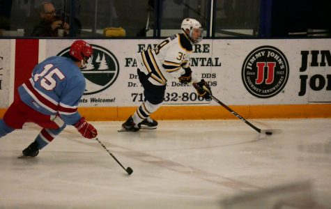 Simon Sagissor, the second-year forward, handles the puck in the offensive zone.