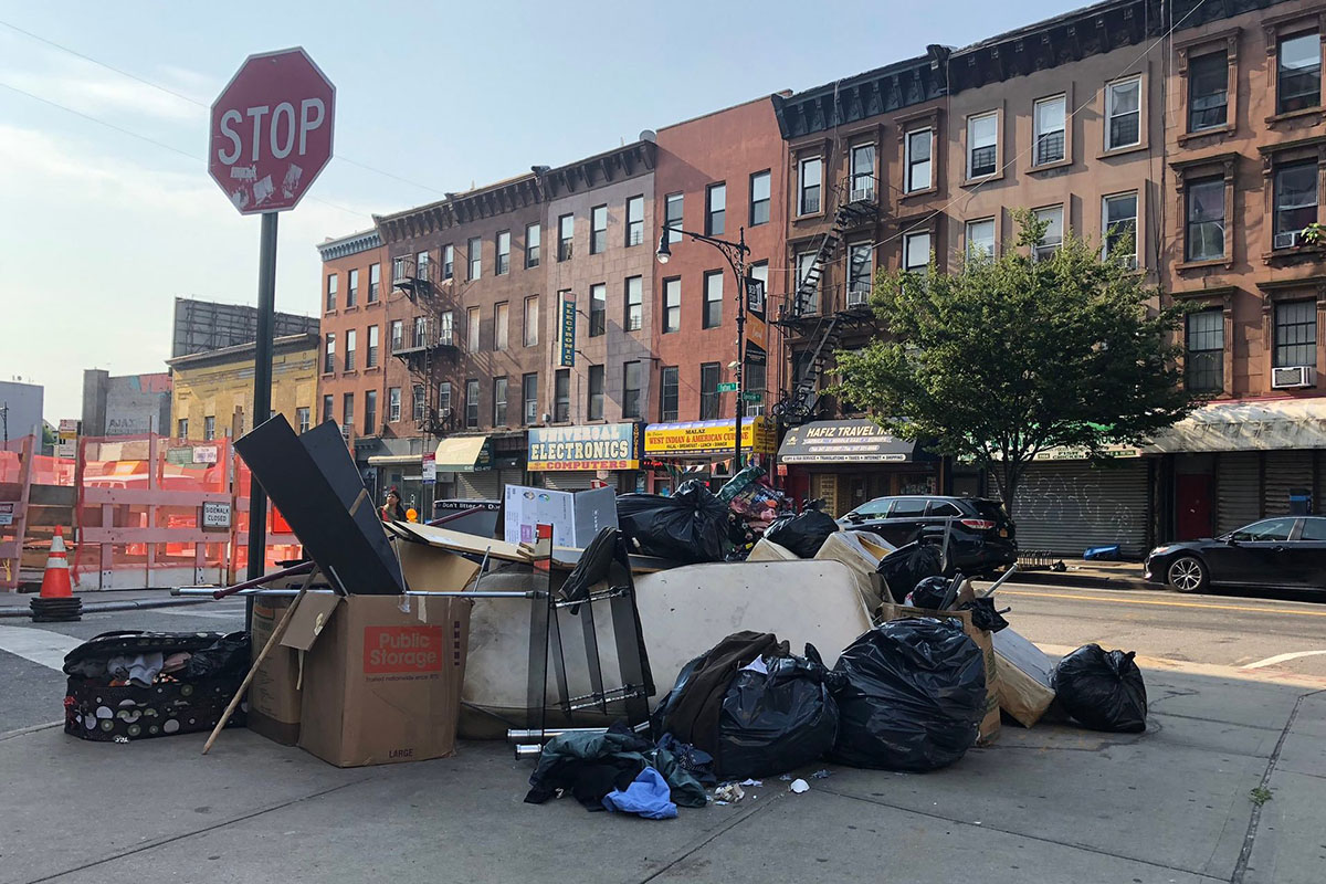 A main source of the garbage mess is the city's system of picking up garbage curbside instead of allowing buildings to set their trash in larger bins off the sidewalk.