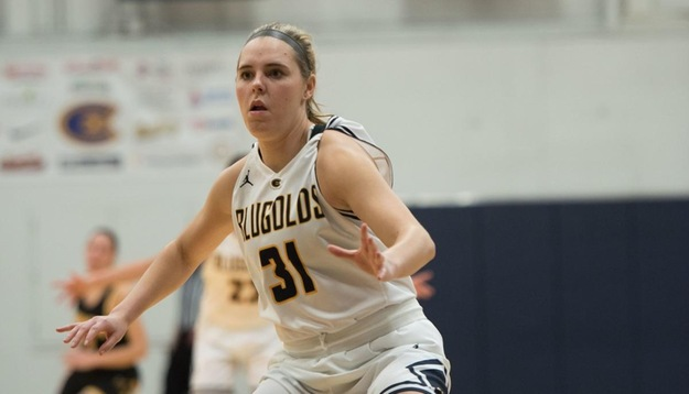 Ellie Clayton plays defense in the Blugolds' 69-54 loss against Wartburg College.