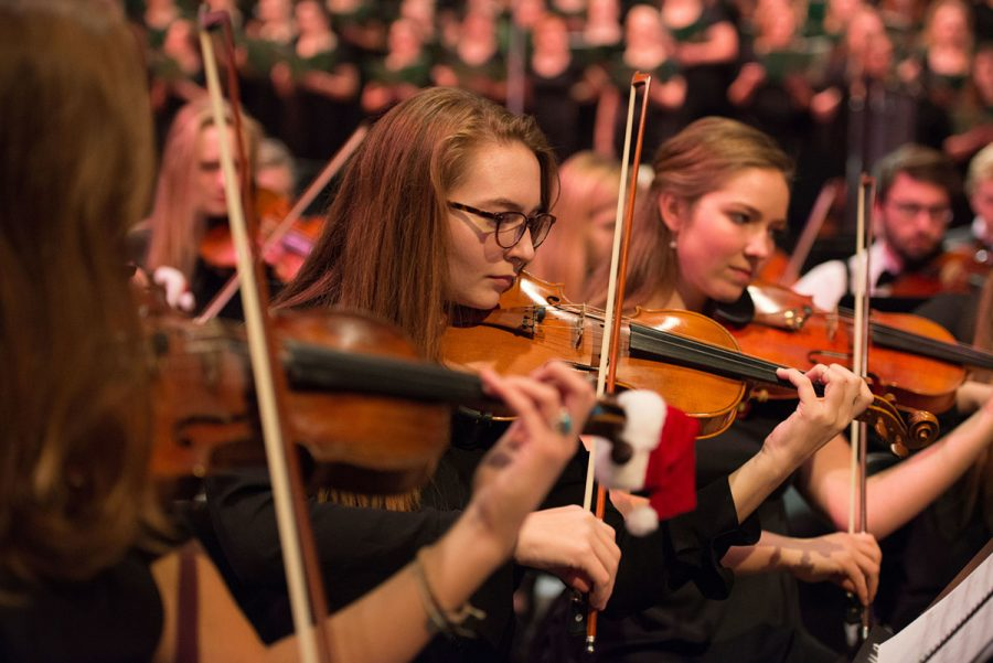 Various music groups from UW-Eau Claire perform at the Pablo Center during the 45th annual holiday concert. Each group played two to three pieces total,  with 26 pieces performed in total.