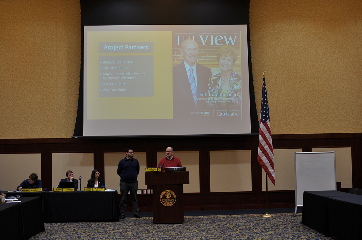 Mike Rindo, assistant chancellor for facilites and university relations, and Jacob Wrasse give a presentation.