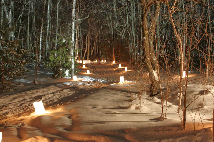 A photo of the candlelit hike at Lake Wissota State Park. Participants can choose to snowshoe, ski or walk.