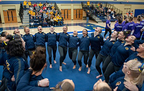 Blugolds gymnastics team motivates one another to prepare for their meets.