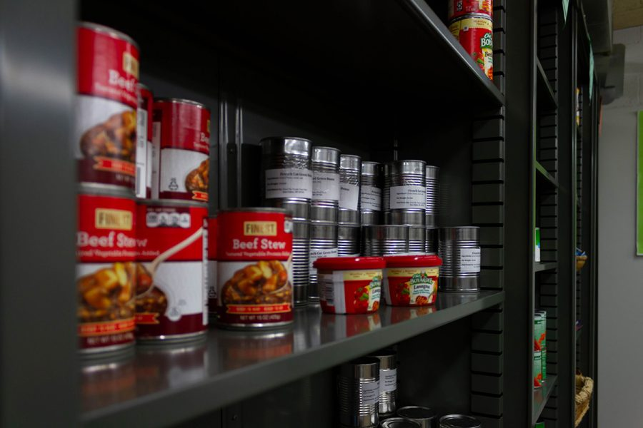 Cans of food on a shelf.
