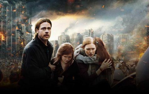 A man, women and two girls in front of a burning city.
