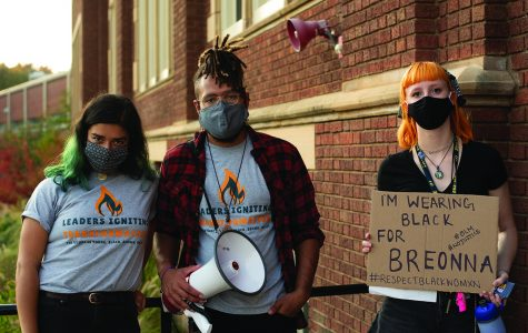 "Event organizers Stephanie Hoeksema, Jacksen Wolff and Maja Samec stand outside of Schofield Hall after the ""Cops off Campus: Dare to Divest"" rally. The group posted messages onto Chancellor James C. Schmidt's office."