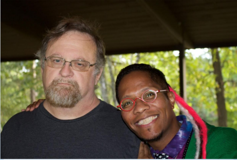 """Michael Penkava (left) sits with aBa Mbirika (right) at """"Math in the Woods"""" in Carson Park."""
