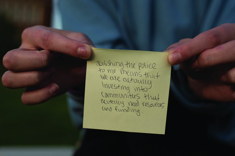 Community members gathered on the campus mall to stand in solidarity with Black, Indigenous and People of Color (BIPOC). At the end of the rally, organizers asked participants to write on a sticky-note what police divestment means to them.