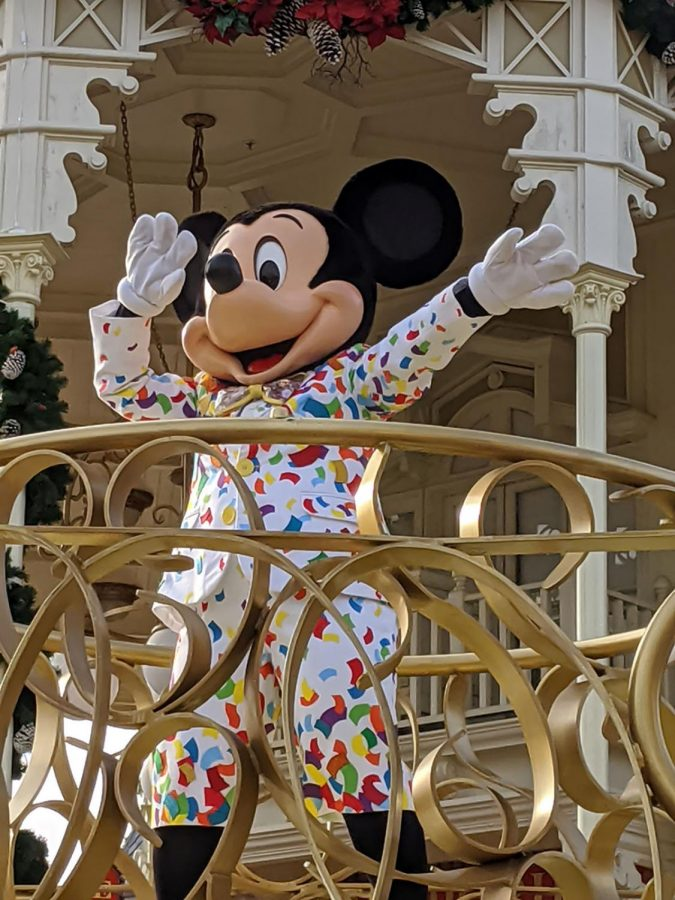 Mickey Mouse waves to the crowd during a parade at Magic Kingdom in Disney World. Frequent parades are Disney's alternative to traditional character meet-and-greets amid the COVID-19 pandemic.