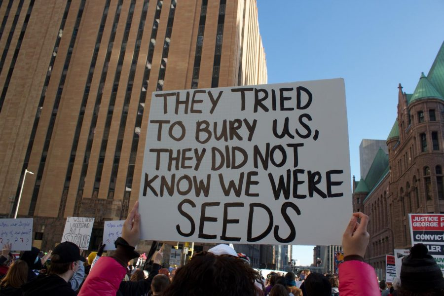 "A sign carried by one of the participants said, ""They tried to bury us, they did not know we were seeds."""