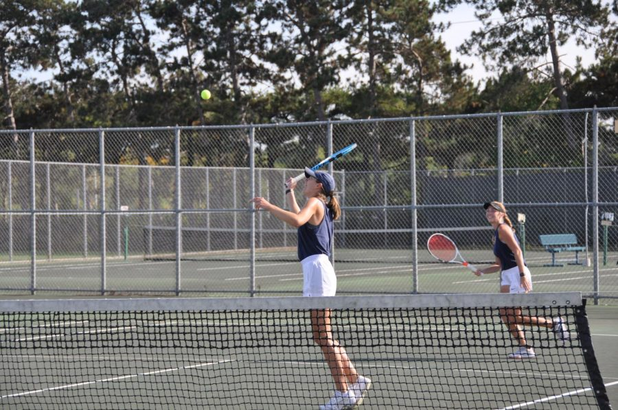 Doubles partners, Henderson and Franta, serve a tennis ball as they practice against their fellow teammates for their national tournament. Both place 2nd overall at the ITA tournament and will play at Berry College in Georgia for the national ITA competition.