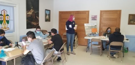 UWEC Nursing students (left) provide vaccines and health screenings while Rural Voices/Voces del Campo interns Claire Ganshow (center) and Alexis Polencheck (right) conduct oral history interviews for the Western WI COVID-19 Archive