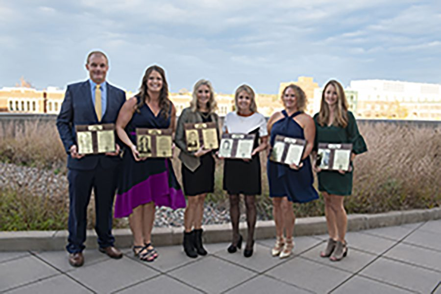 The 2021 Hall of Fame inductees pose with their plaques